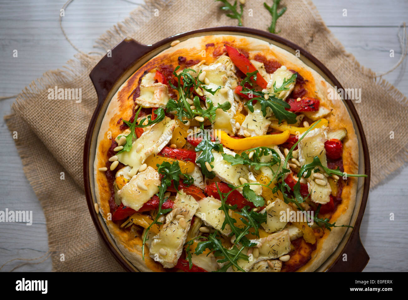 Homemade Vegetarian Pizza with Peppers, Brie & Rocket - Stock Image