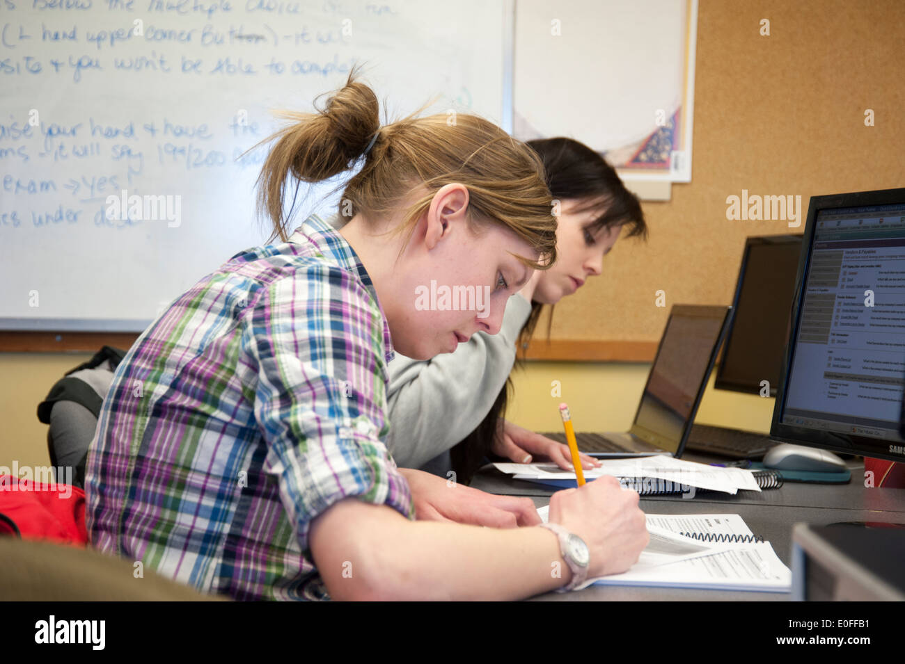 Adult women students in a learning environment classroom with computers - Stock Image