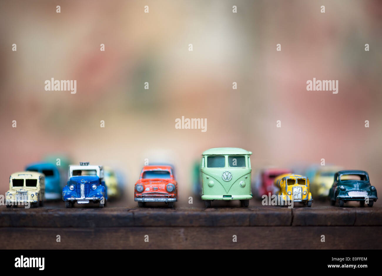 Old playworn Dinky, Lesney toy van, lorry and cars, in a line - Stock Image