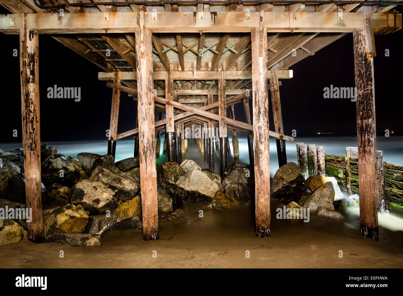 A light painted image of Balboa Pier underside taken at 4:00 AM with a slow exposure shows the intricate detail Stock Photo