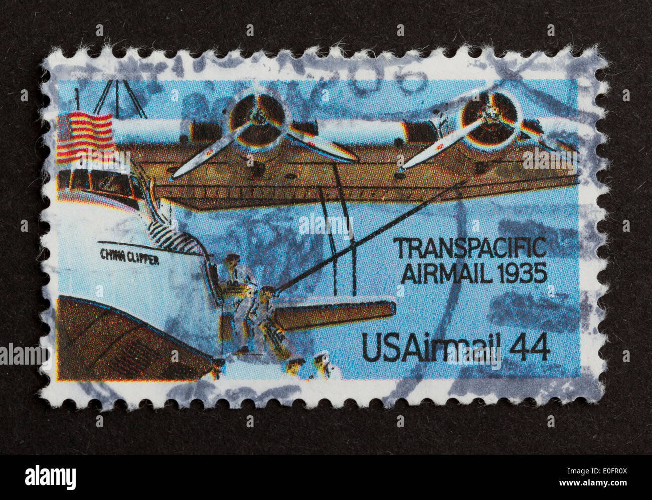 USA - CIRCA 1975: Stamp printed in the USA shows a airplane from the Transpacidic Airmail 1935, circa 1975 Stock Photo