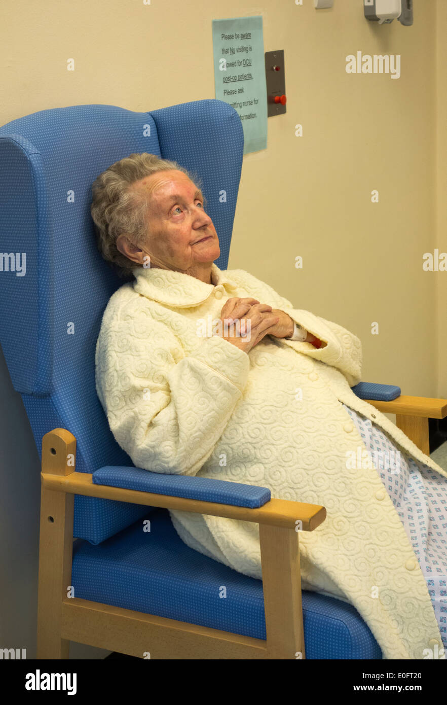 Elderly lady in her nineties in Hospital day care unit examination room being prepared for general anaesthetic. - Stock Image