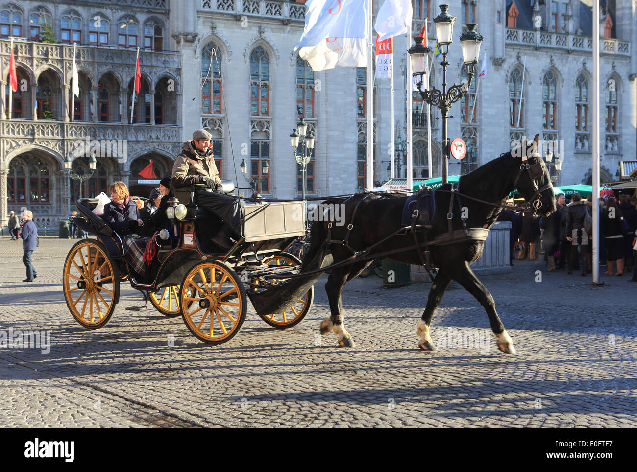 35fa1d78f2c Tourist horse and carriage on Market Square at Christmas time in Bruges