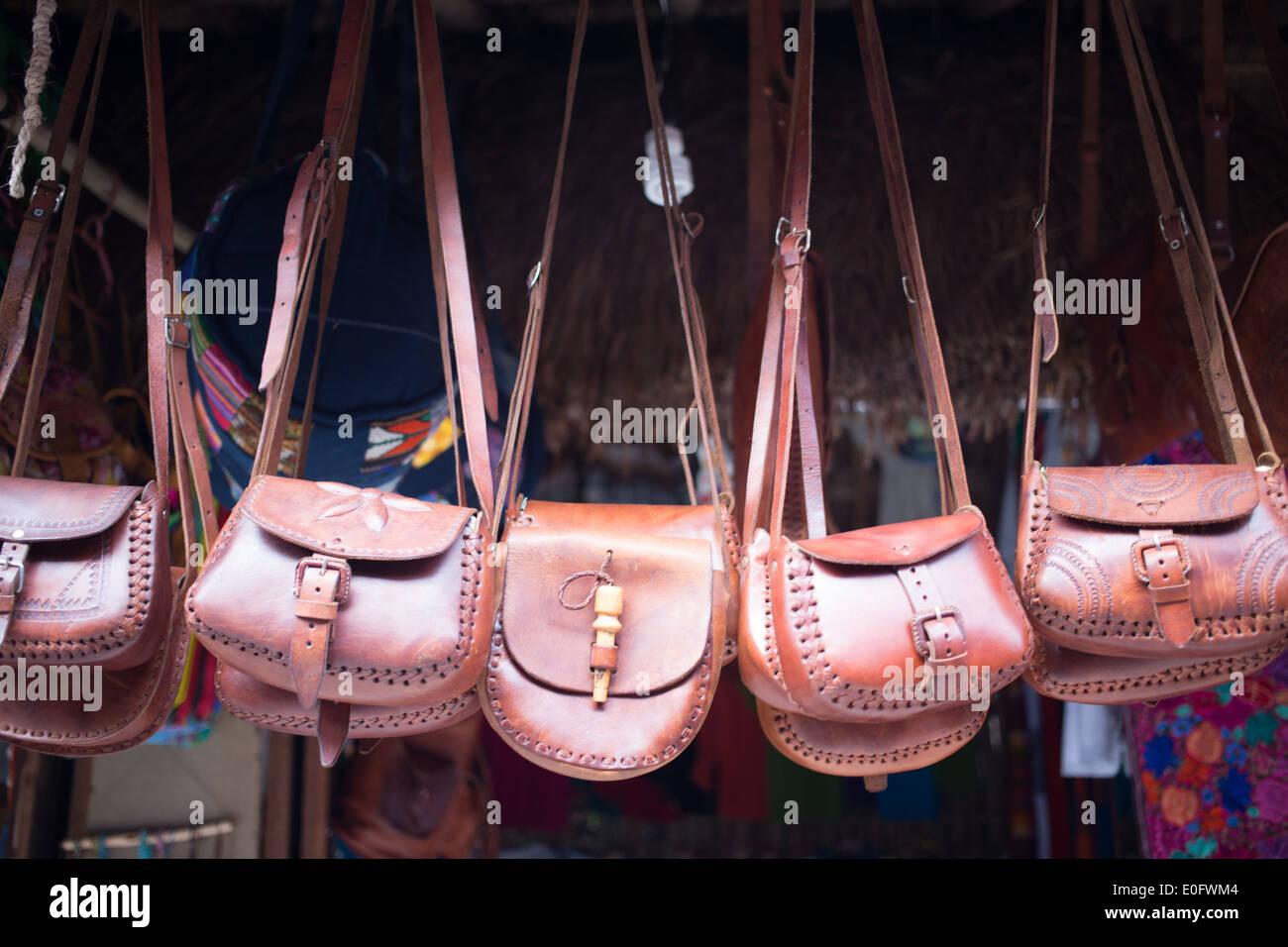 Leather purses for sale at street vendor in Tulum, Mexico - Stock Image