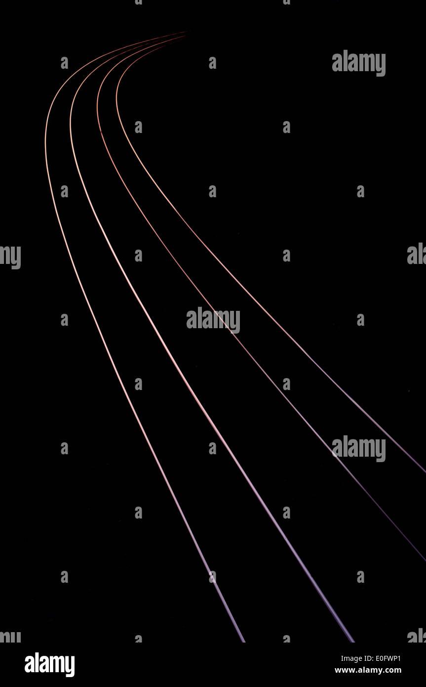 Sunset lit rail tracks - Stock Image