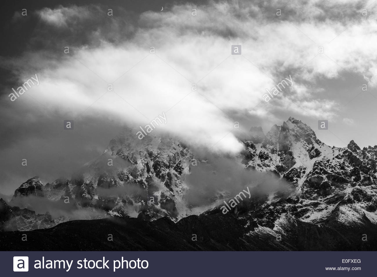 Black and white photo of Himalayan Mountains hidden in clouds, Nepal - Stock Image