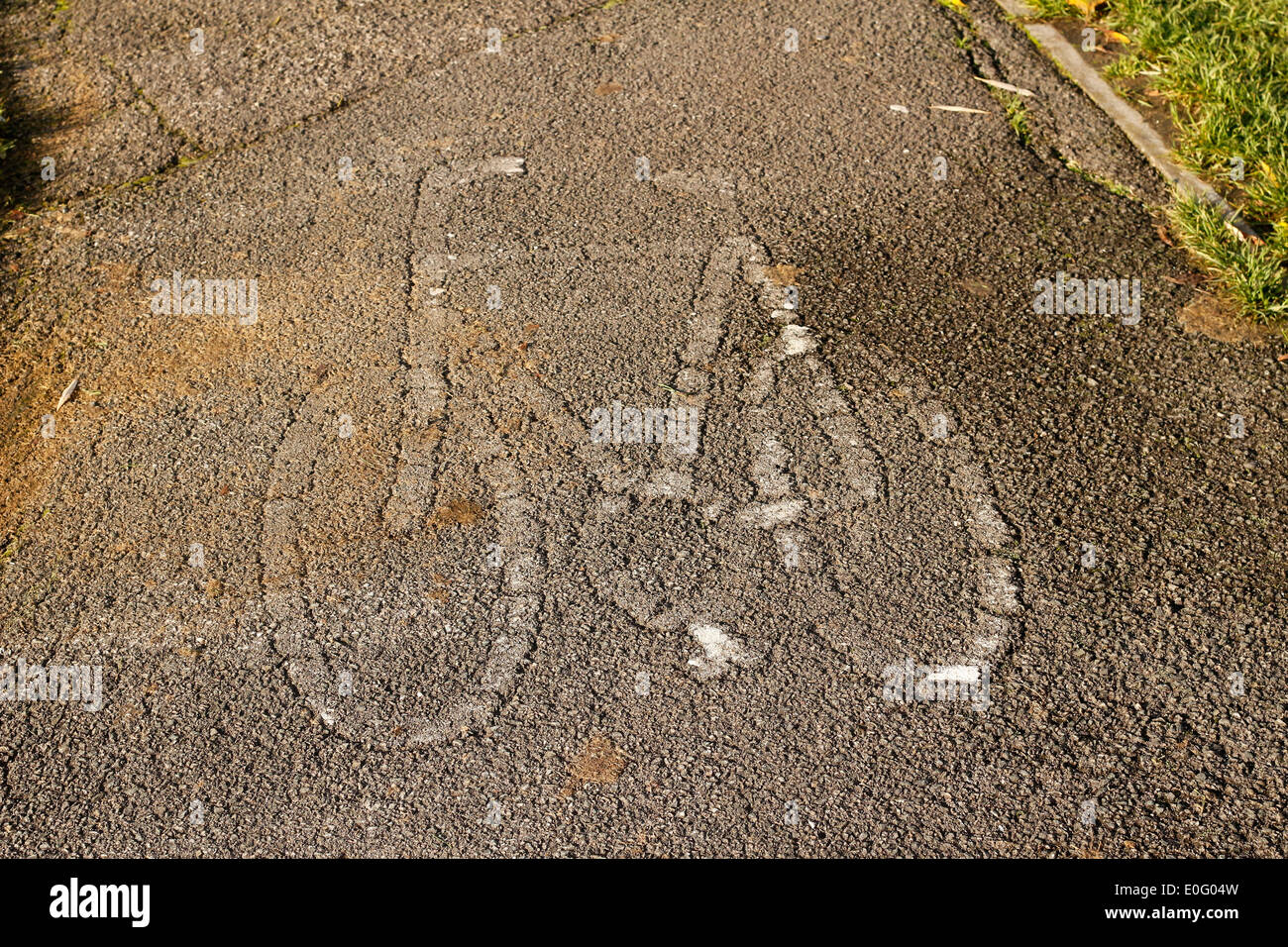 Worn out cycle path marking  in Bradley Stoke, Bristol, November 2013 - Stock Image