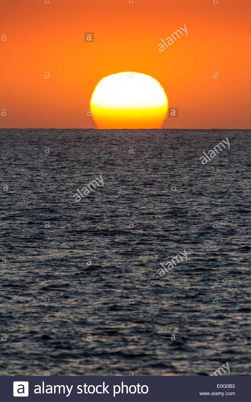 Sunset on the Pacific Ocean off of Hawaii, USA - Stock Image