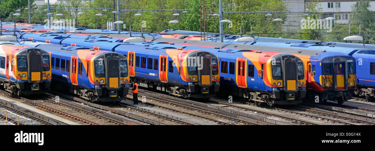 Part of South West Trains passenger fleet in depot adjacent to  Clapham Junction railway station London England - Stock Image