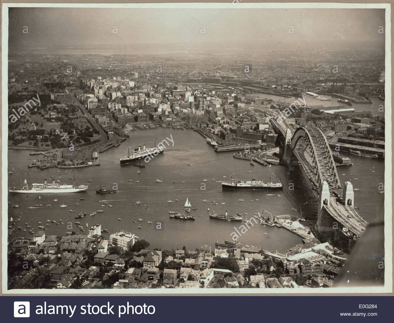 Aerial view of Sydney and Circular Quay on the day of the official opening of the Sydney Harbour Bridge, 19 March, 1932 - Stock Image