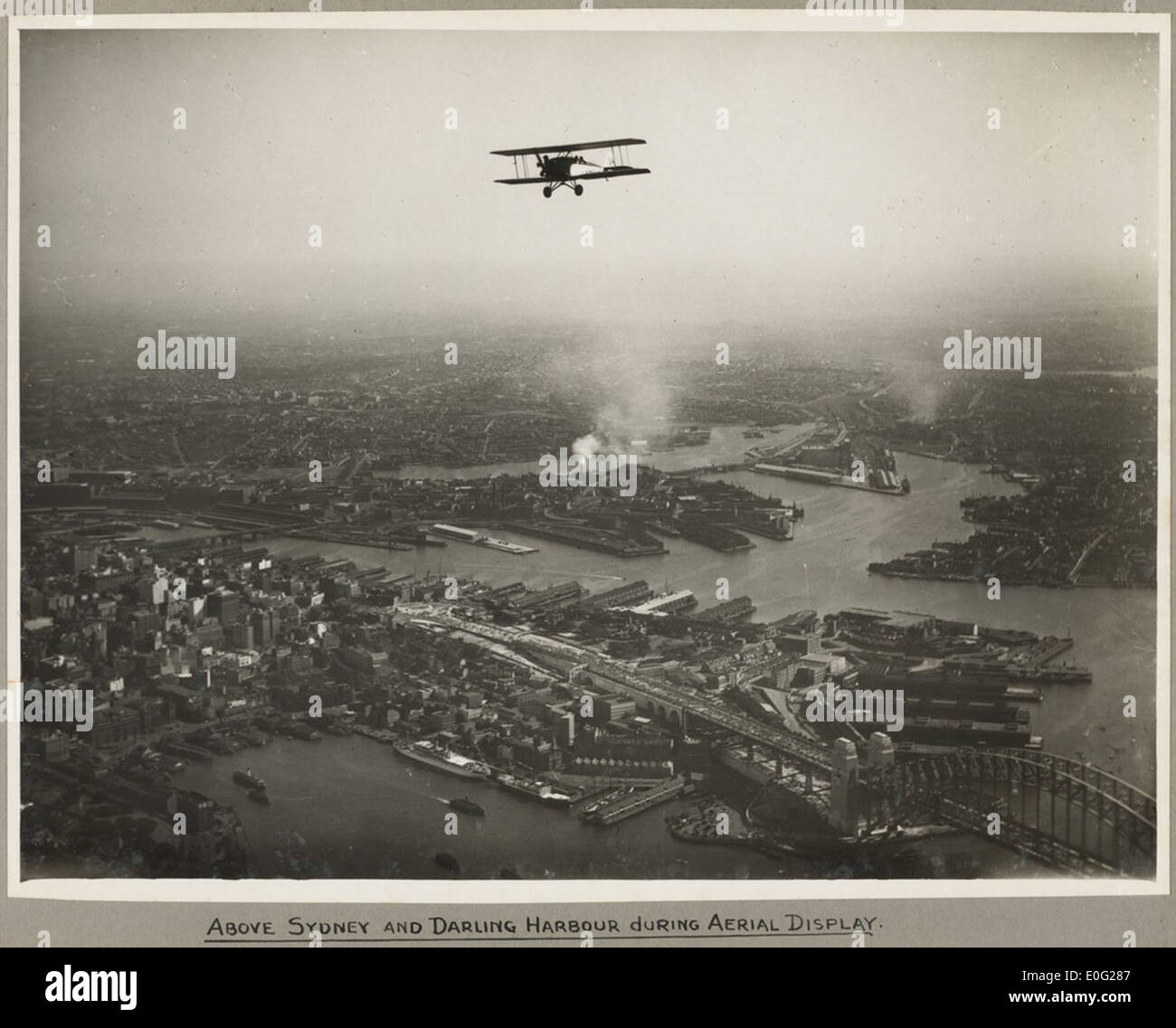 Aerial view of Sydney and the Harbour Bridge on the day of the official opening celebrations of the Sydney Harbour Bridge, 19 March, 1932 - Stock Image