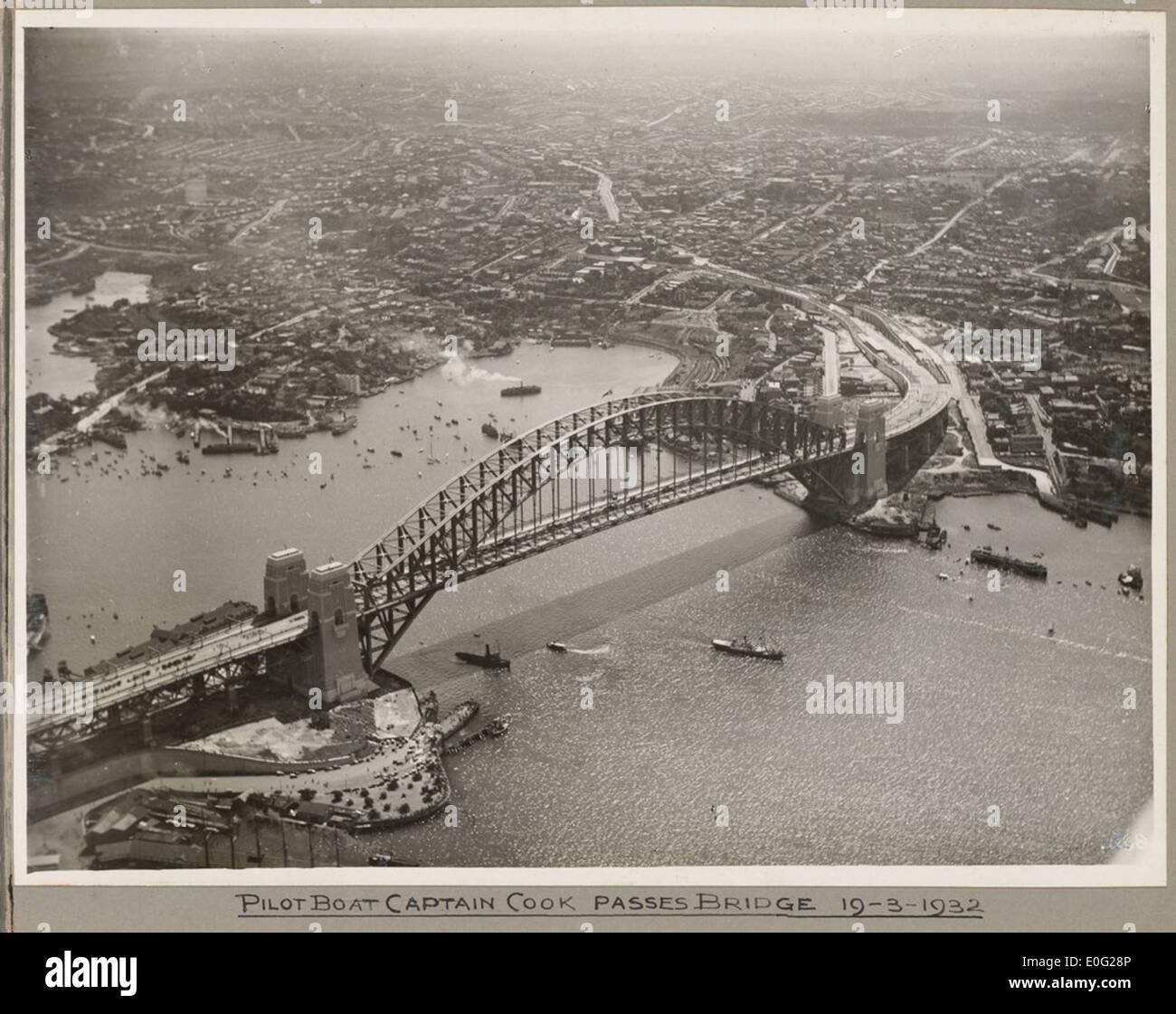 Pilot boat Captain Cook passing under Sydney Harbour Bridge, 19 March 1932 - Stock Image