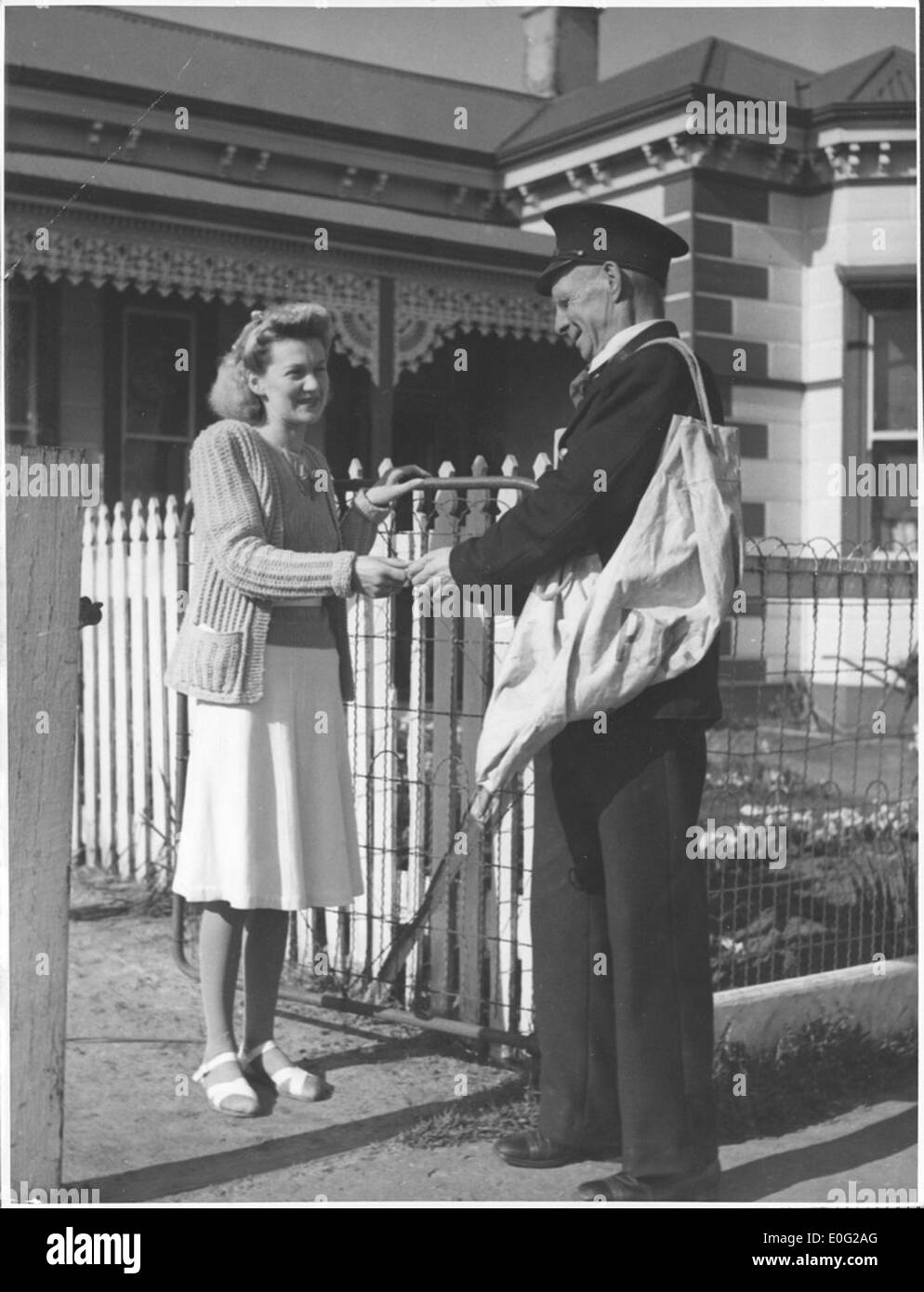 John H. Lowin, who delivers Drouin's mail, has a letter for Mrs Leslie Allison of Drouin, Victoria Stock Photo