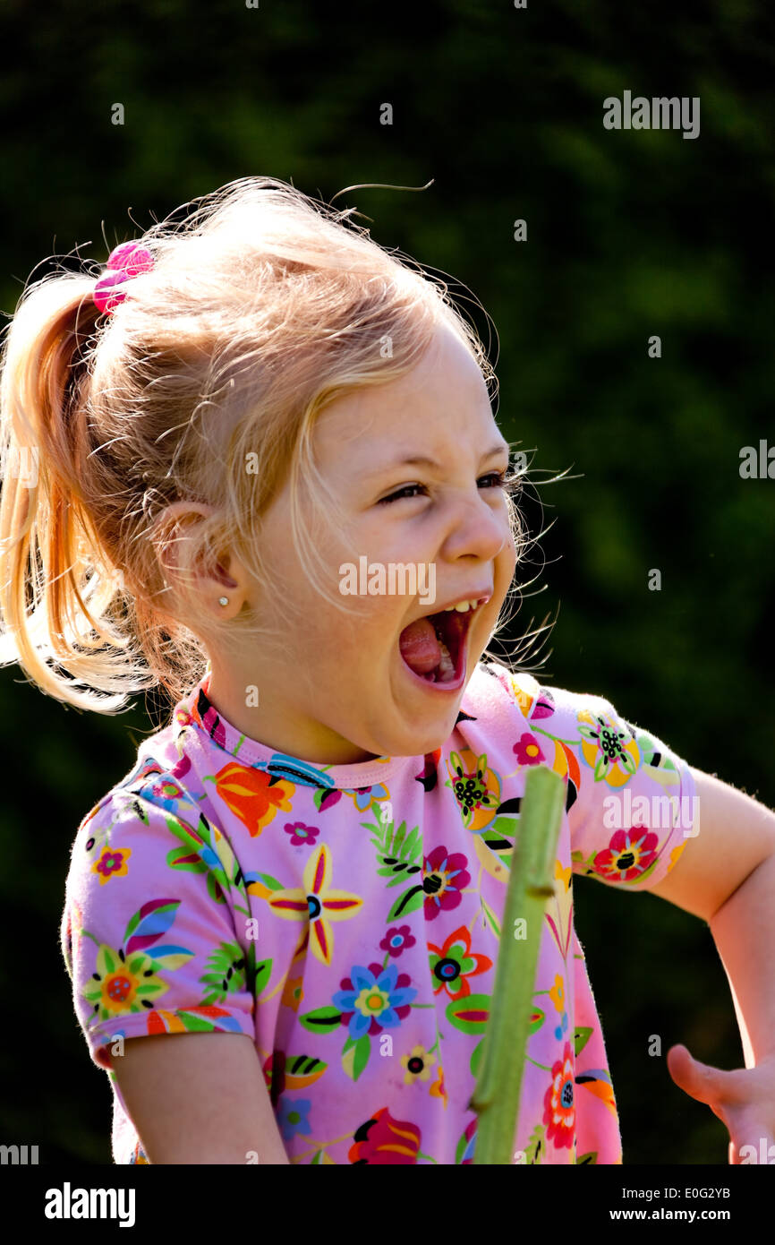 Small child roars with laughter and decently, Kleines Kind lacht lauthals und herzhaft - Stock Image