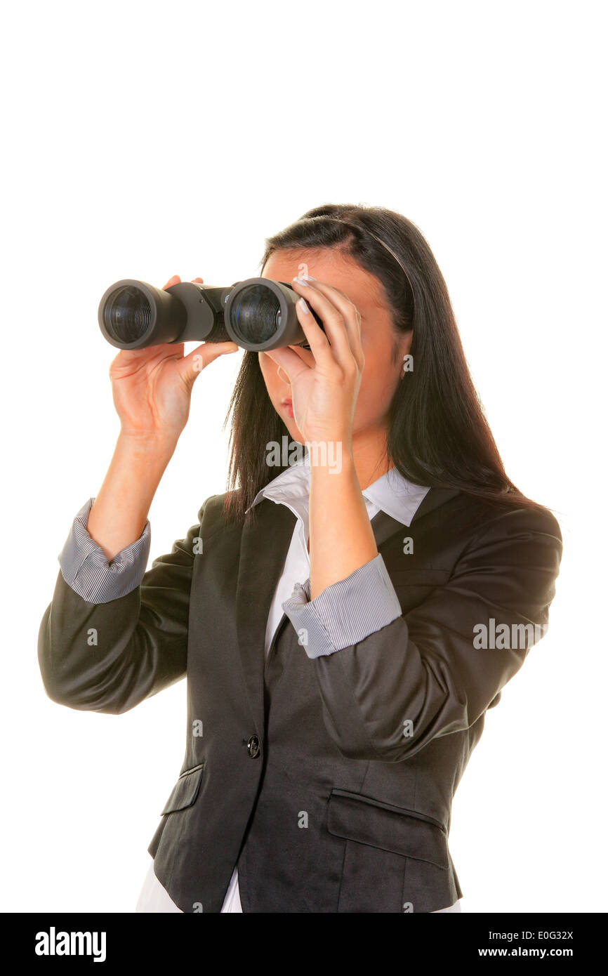 Young woman with binoculars searches the future, Junge Frau mit Fernglas sucht die Zukunft - Stock Image