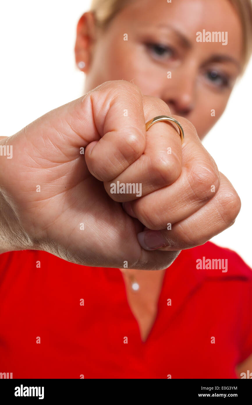 A young woman clenches hand to the fist. Symbolic photo for fury and more badly., Eine junge Frau ballt Hand zur Faust. Symbolfo - Stock Image