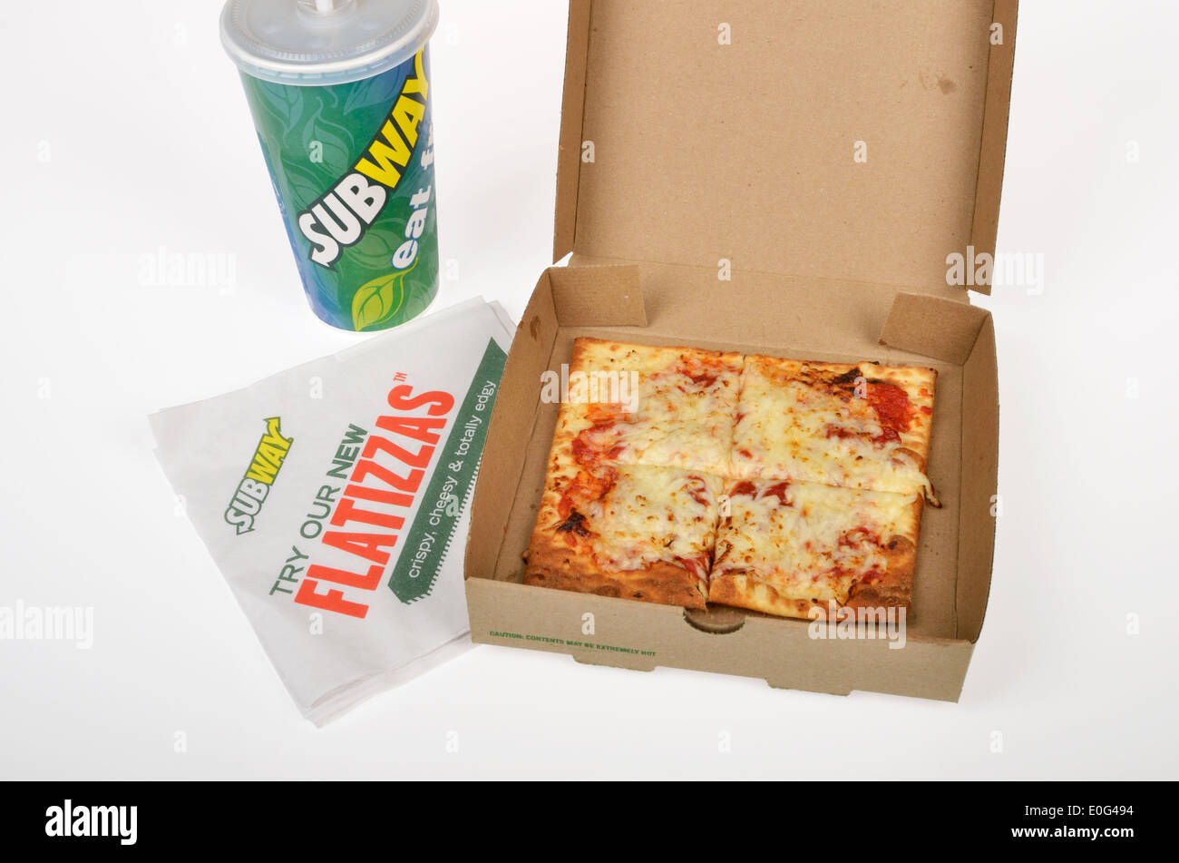 subway flatizza cheese pizza with soda and napkin in open takeaway