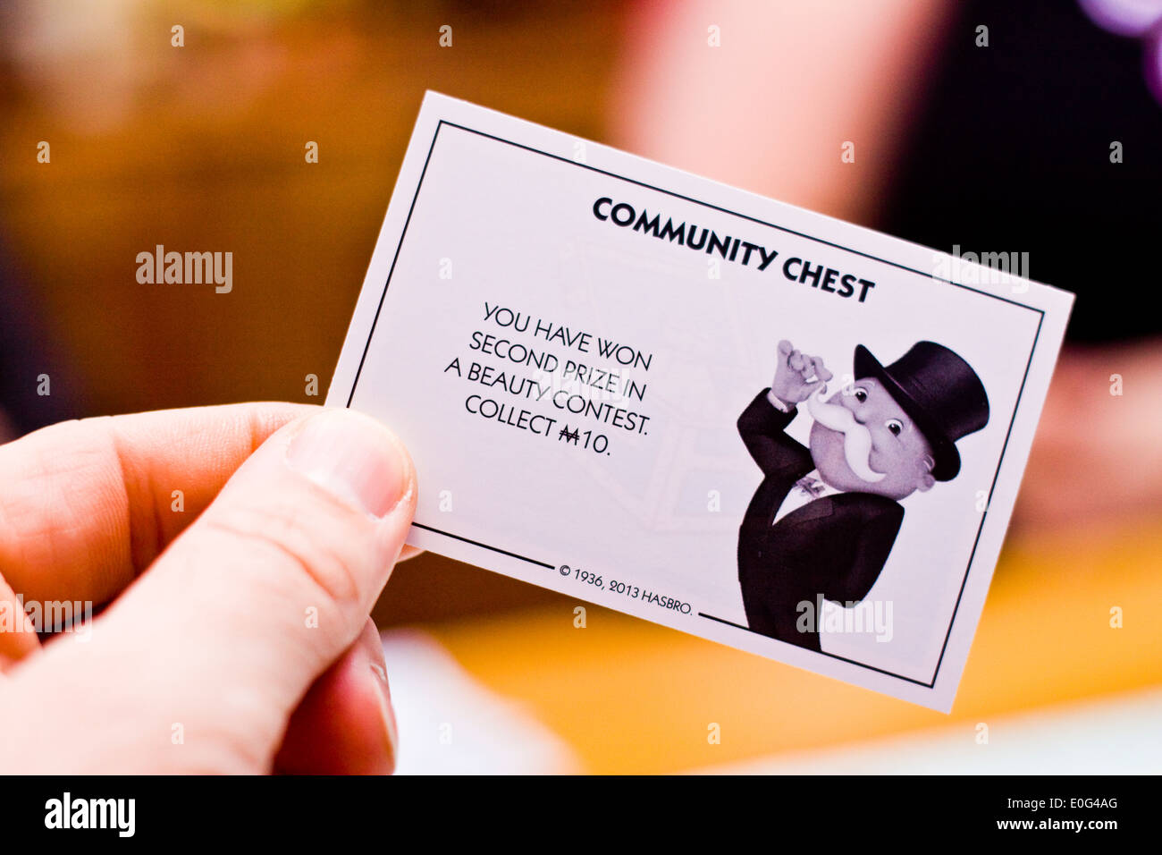 A community chest card from a game of Monopoly - Stock Image