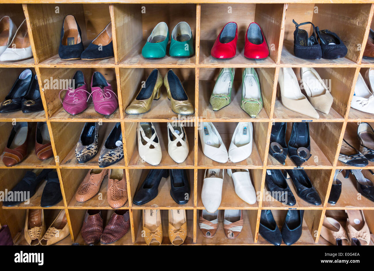 Vintage shoes shop display in a charity shop thrift consignment store Stock Photo