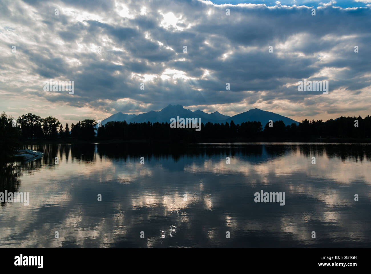 High Tatra (Tatra) Mountains visible from Bielinski Rybnik (Pond) at the sunset, near Spišská Belá (Spisska Bela), Slovakia - Stock Image