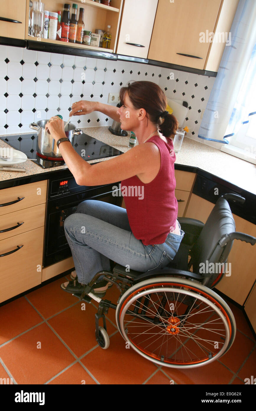 Woman in the wheel chair [], population, population, to, woman, women, gender, society, social classes, people, person, person, - Stock Image