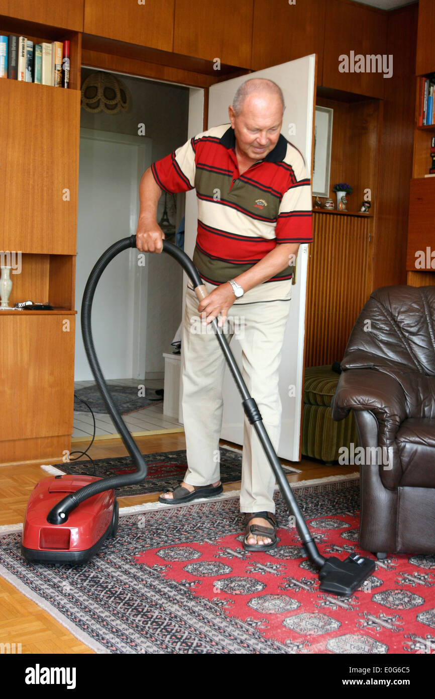 Boss while hoovering [], 60 +, old, old, old men, to old, age, old man, older men, to older, older, older man, age group, fuenzi - Stock Image