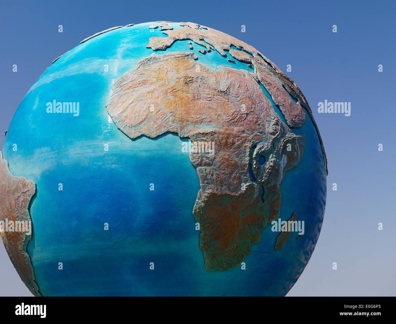Earth globe sculpture over blue sky in Tokyo Disneysea - Stock Image