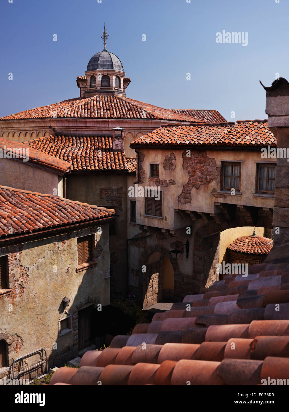 Tiled roofs of old houses in a town built in Venetian architectural style at Tokyo Disneysea - Stock Image