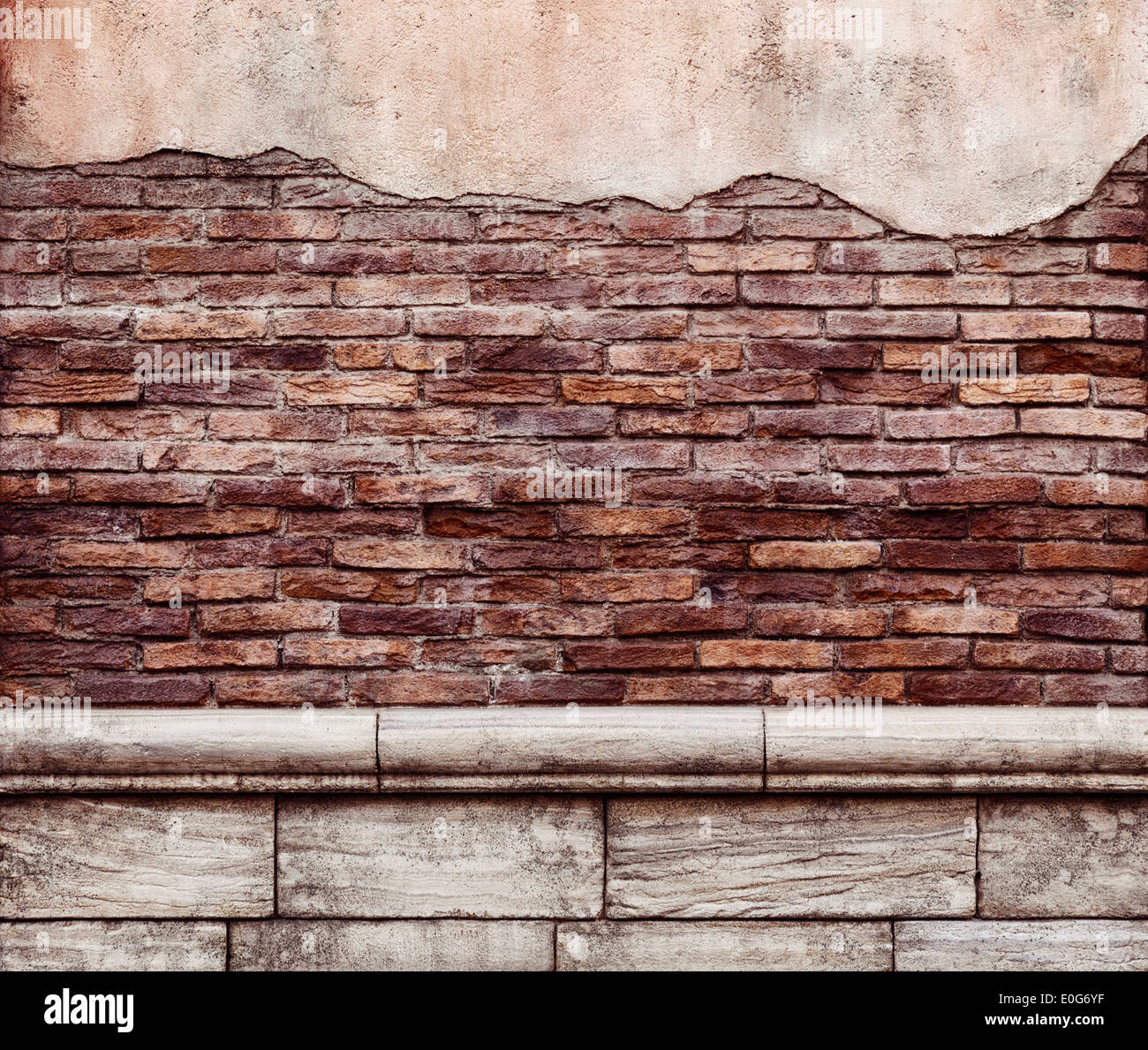 Old grungy brick wall with peeled off stucco rustic texture background - Stock Image