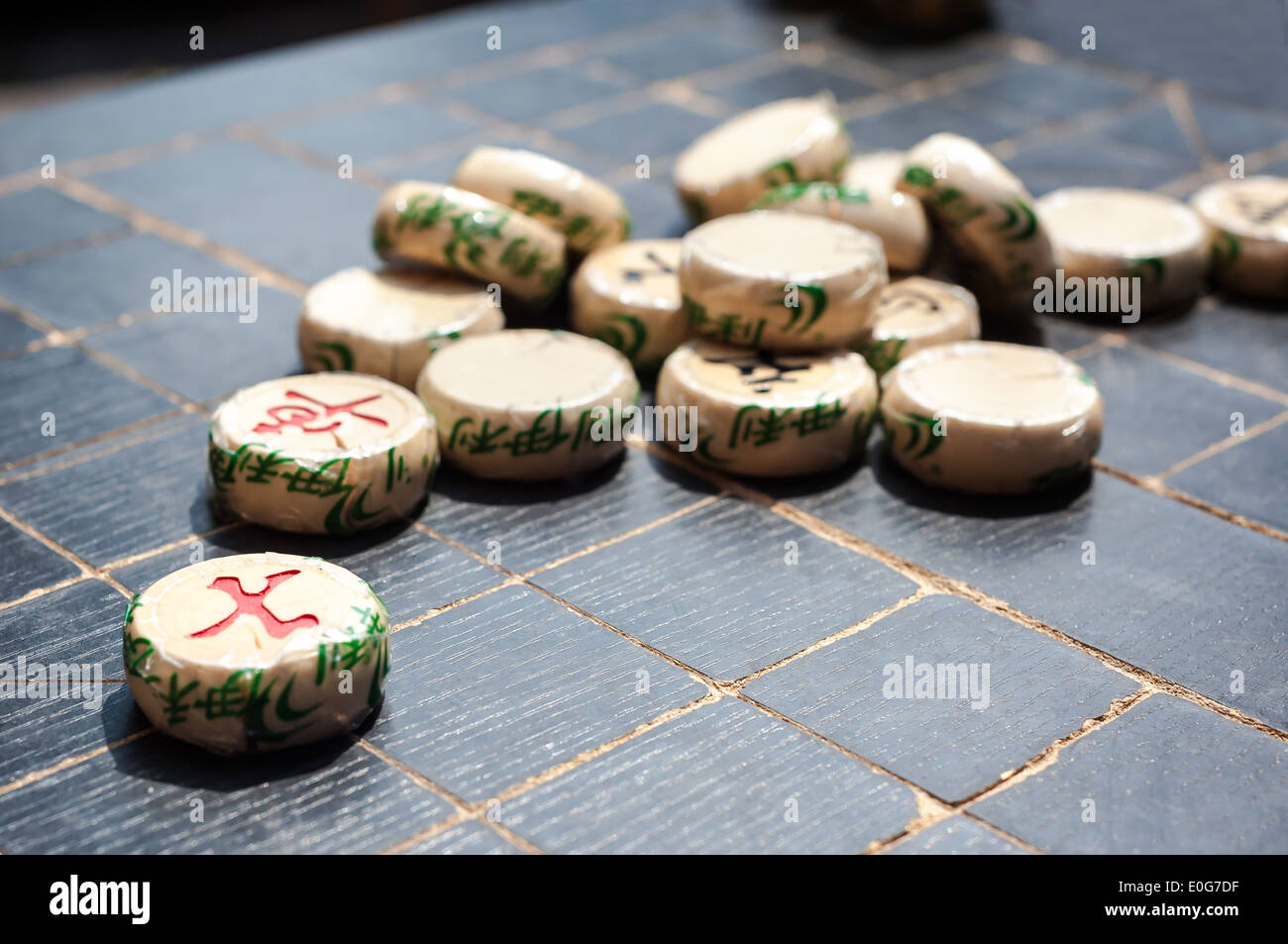 Xiangqi pieces on a Chinese chess board - Stock Image