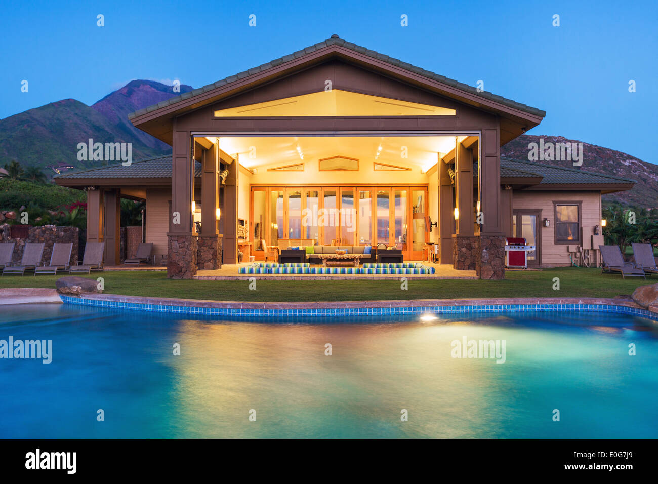 Luxury home with swimming pool at sunset Stock Photo
