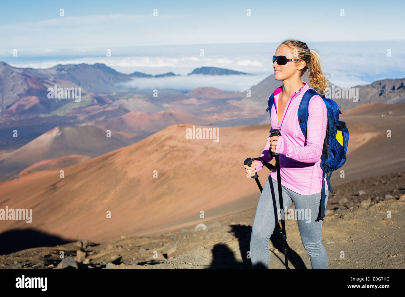 642f4dc890584c Woman hiking on beautiful mountain trail. Trekking and backpacking in the  mountains. Healthy lifestyle outdoor adventure concept