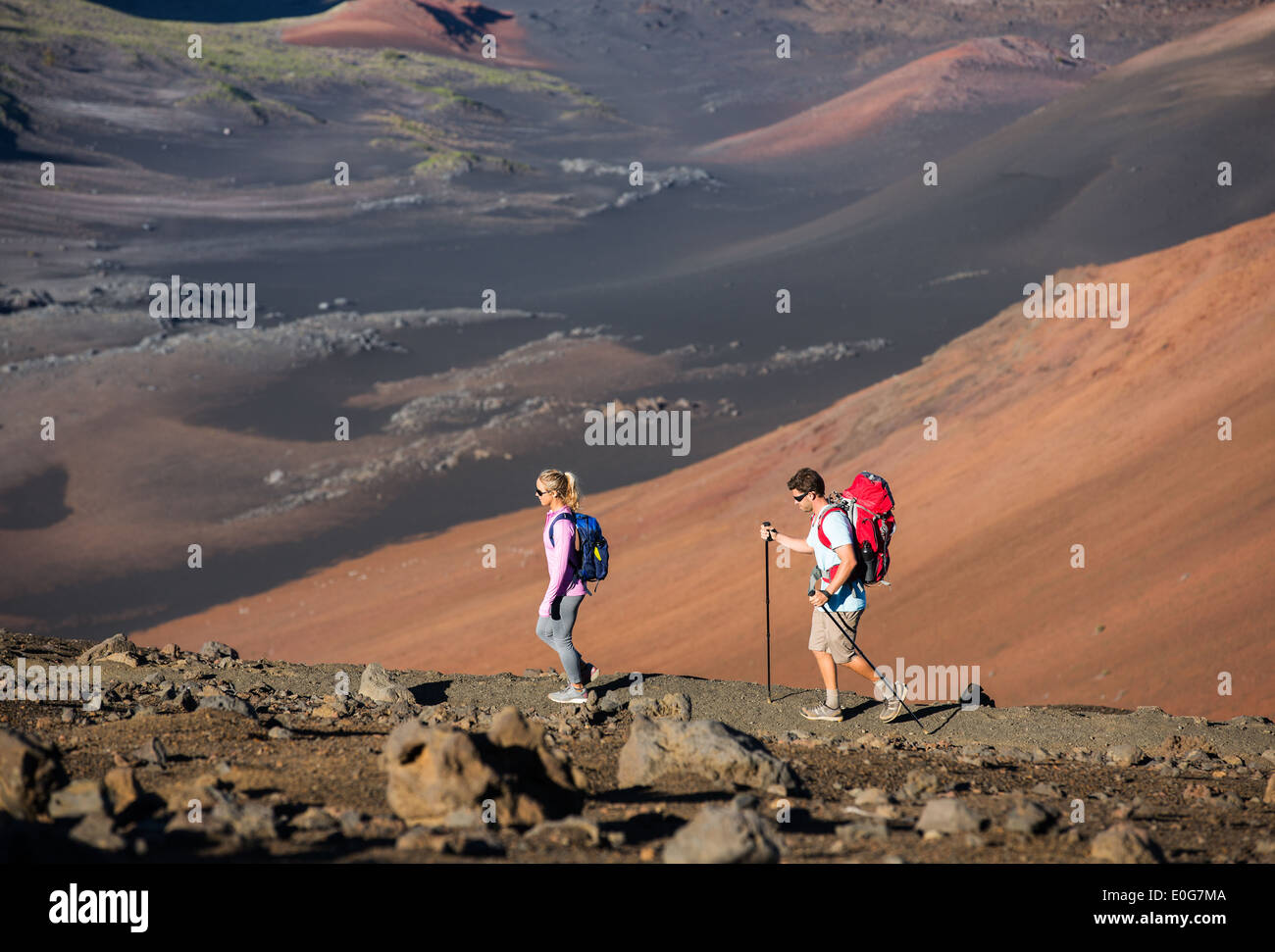 5eb2bb25caad12 Man and woman hiking on beautiful mountain trail. Trekking and backpacking  in the mountains. Healthy lifestyle outdoor adventure