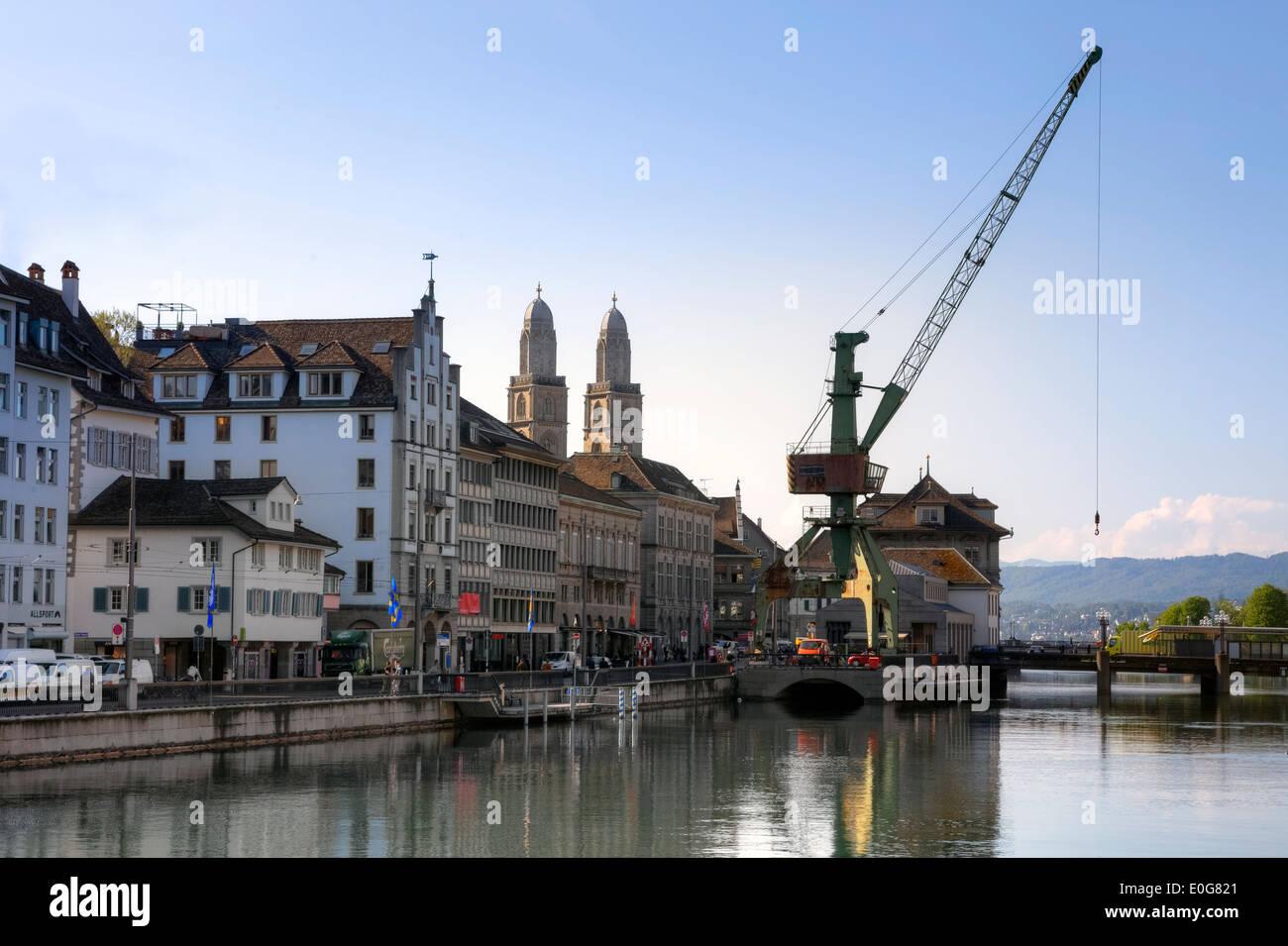 Zurich, Grossmuenster, building crane, Limmat, Switzerland - Stock Image