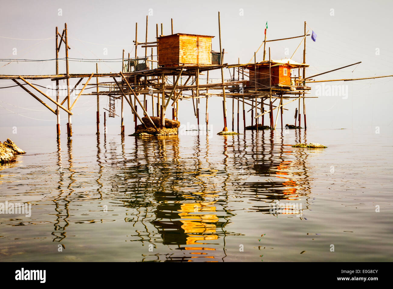 A trabocco, an old fishing machine, in the early morning haze on the Adriatic coast in Abruzzo, Italy. - Stock Image