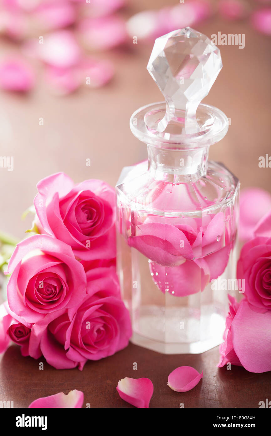 Perfume bottle and pink rose flowers spa aromatherapy stock photo perfume bottle and pink rose flowers spa aromatherapy mightylinksfo