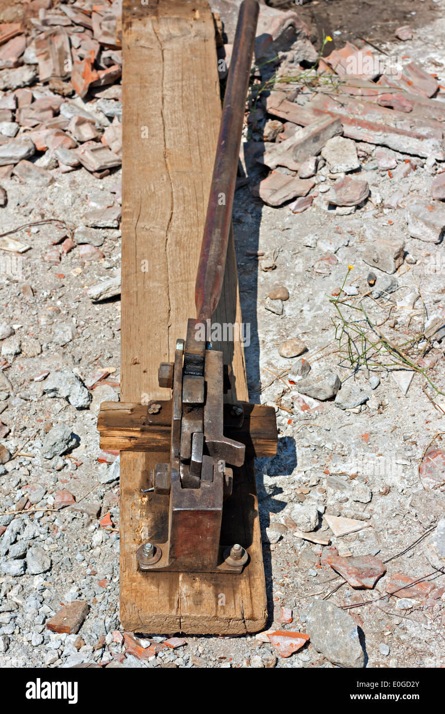 Reinforced steel rod cutter on floor of construction site - Stock Image