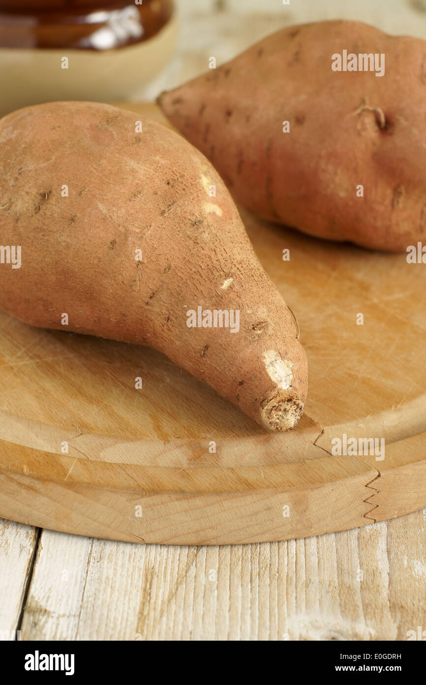 Sweet Potatoes or Ipomoea batatas are sweet tasting tuberous roots and a major food source - Stock Image