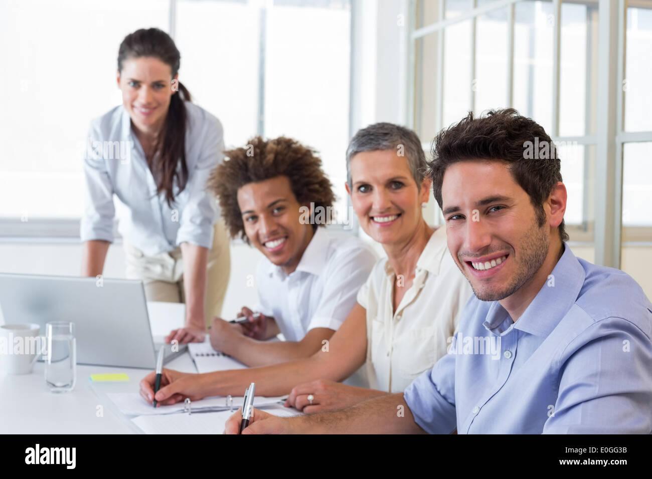 Casual staff smiling at camera - Stock Image