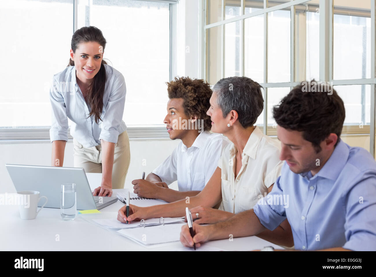 Casual workers at important meeting - Stock Image