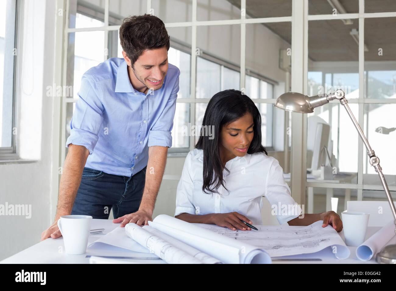 Architects working on important blueprints - Stock Image