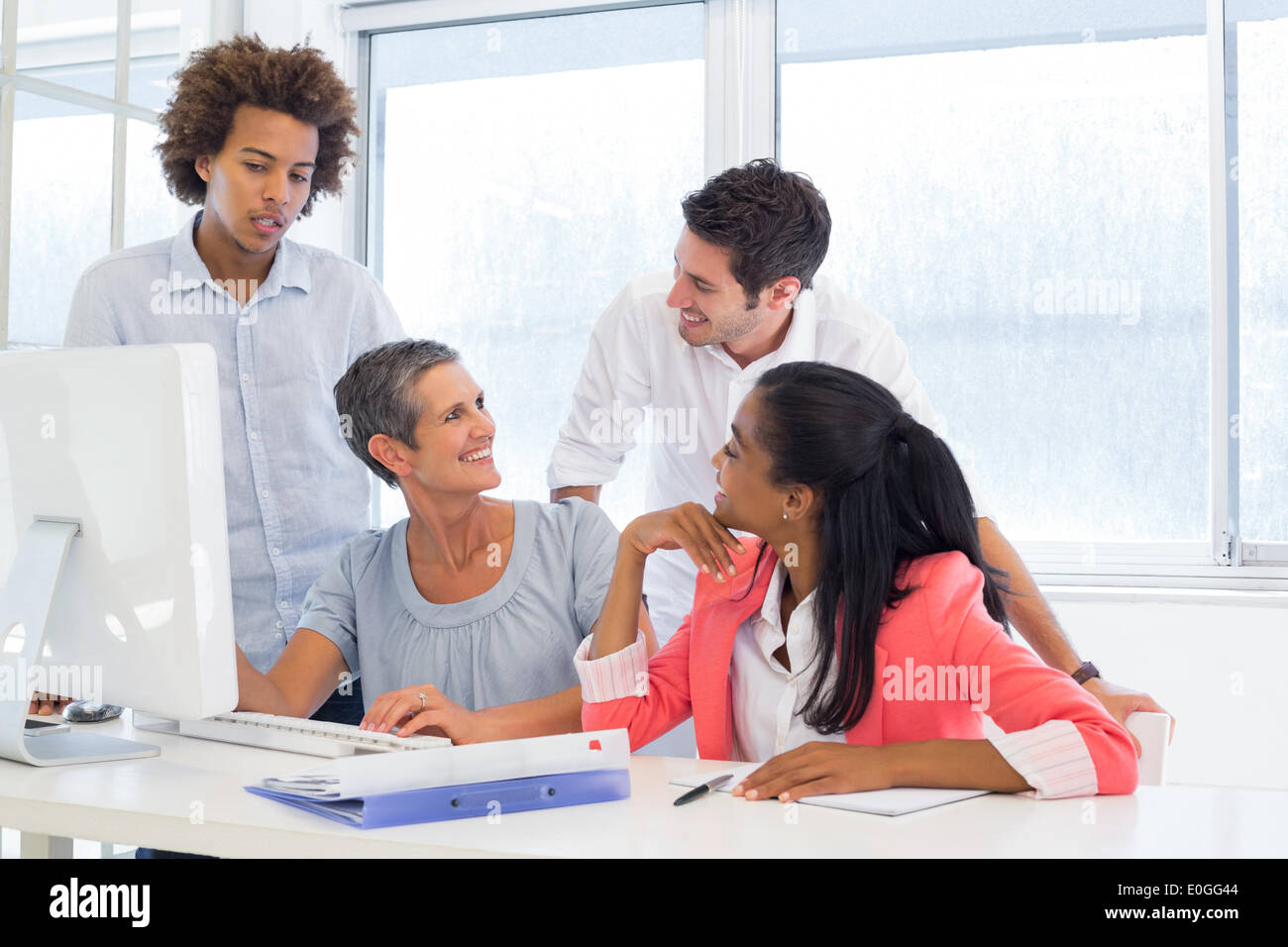 Working smiling and interacting cheerfully - Stock Image