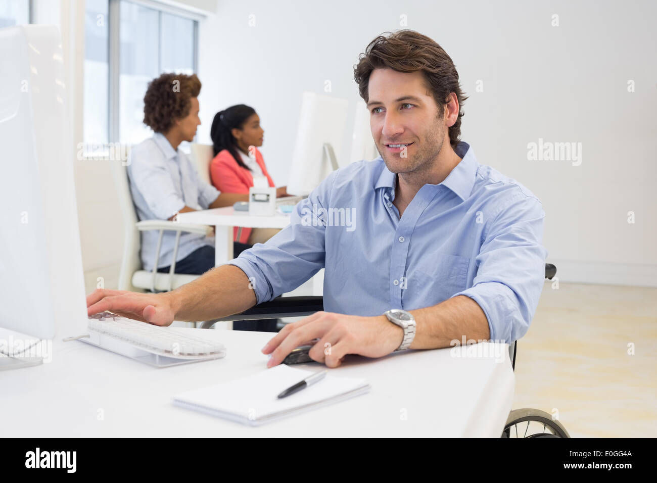Businessman with disability works hard - Stock Image