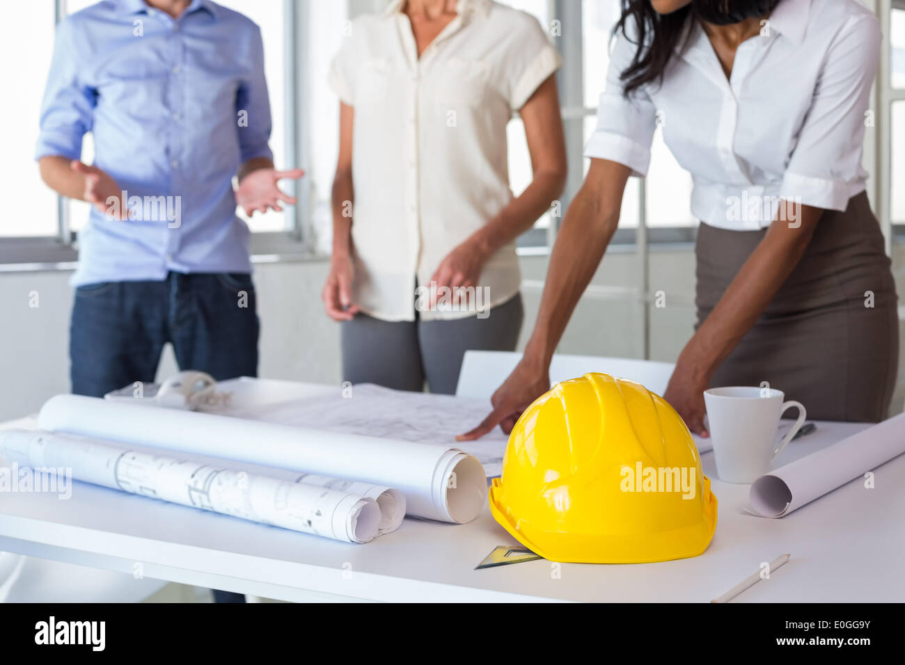 Architects looking at important blueprints - Stock Image