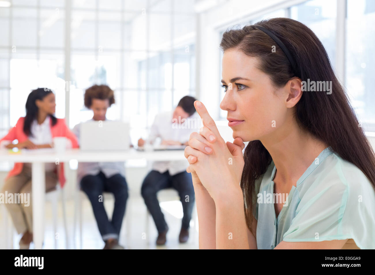 Attractive businesswoman concentrating and focusing - Stock Image