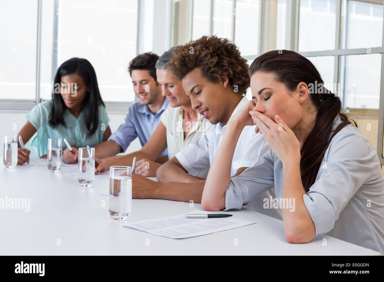 Business people yawning and being bored - Stock Image