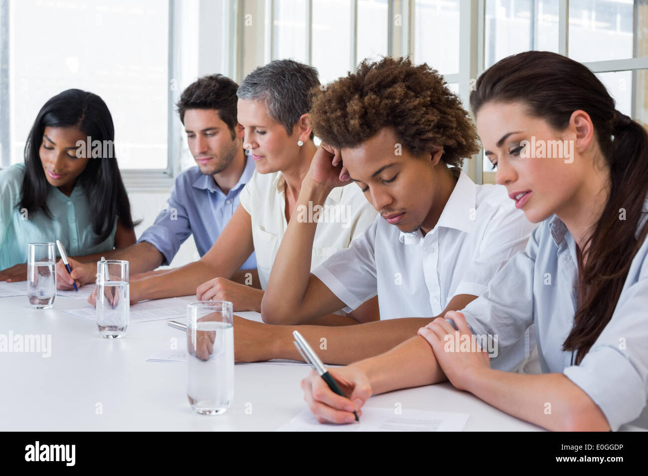 Business people taking down important notes - Stock Image