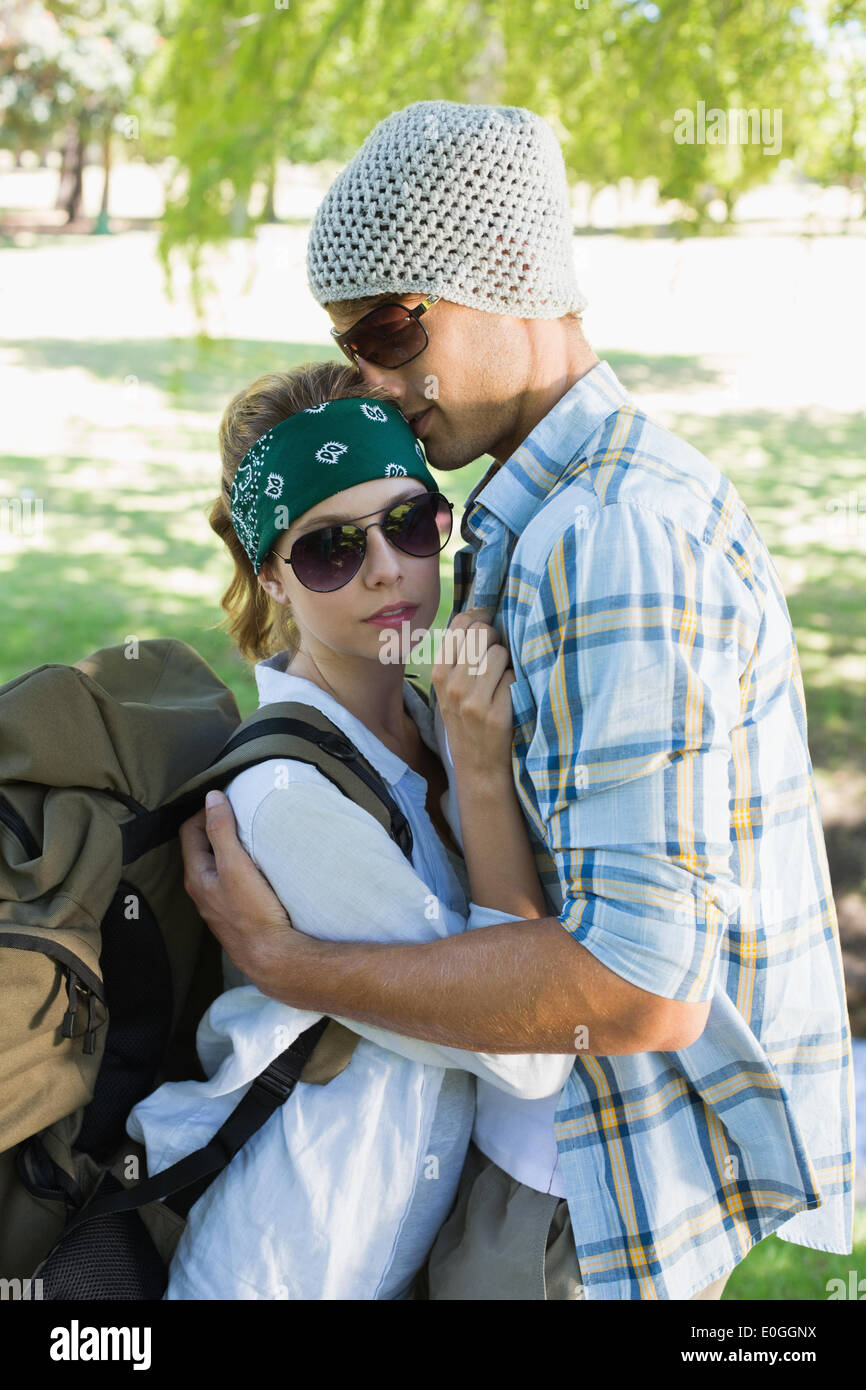 Active couple embracing each other on a hike - Stock Image