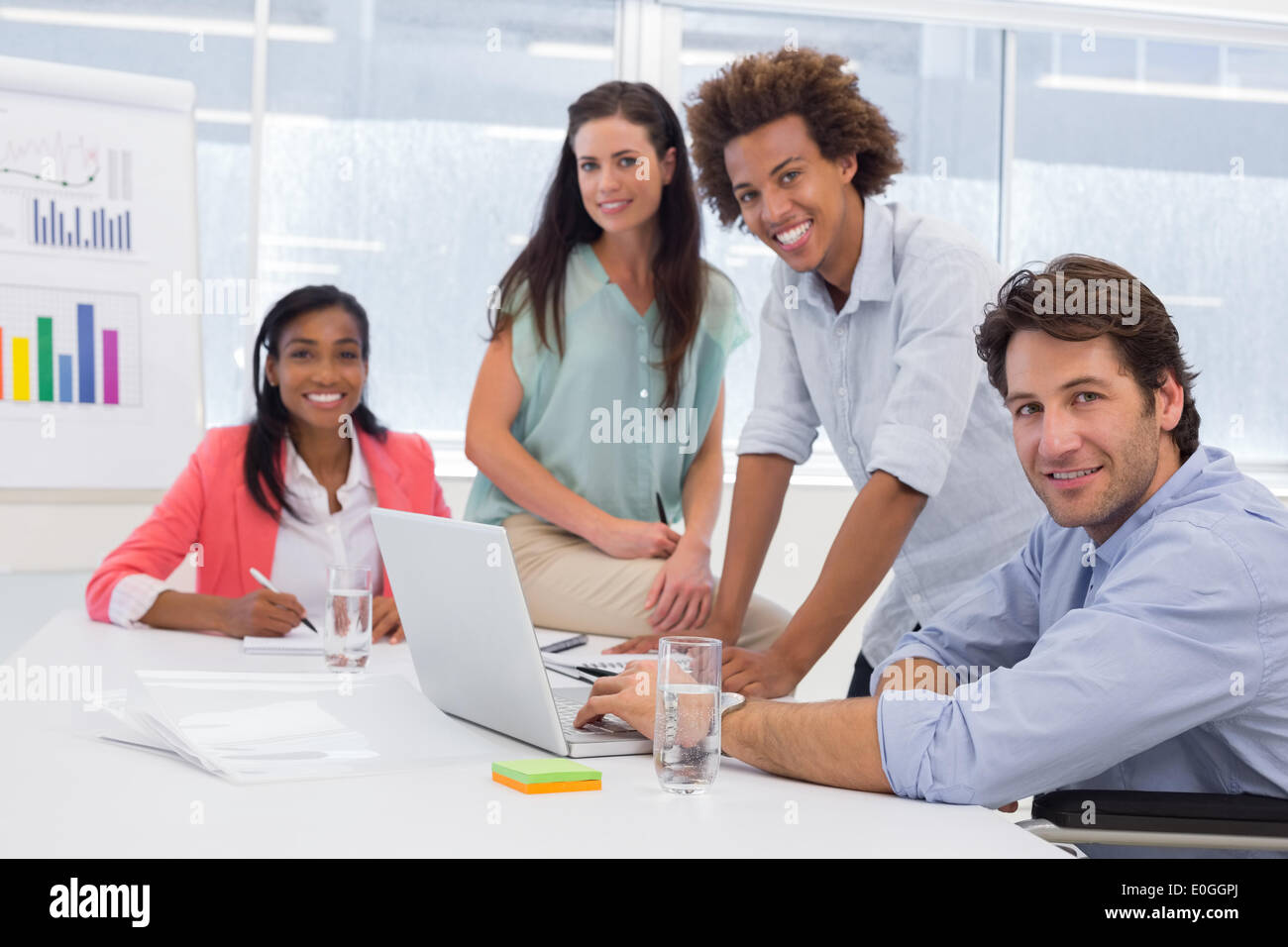 Attractive business people in the workplace - Stock Image