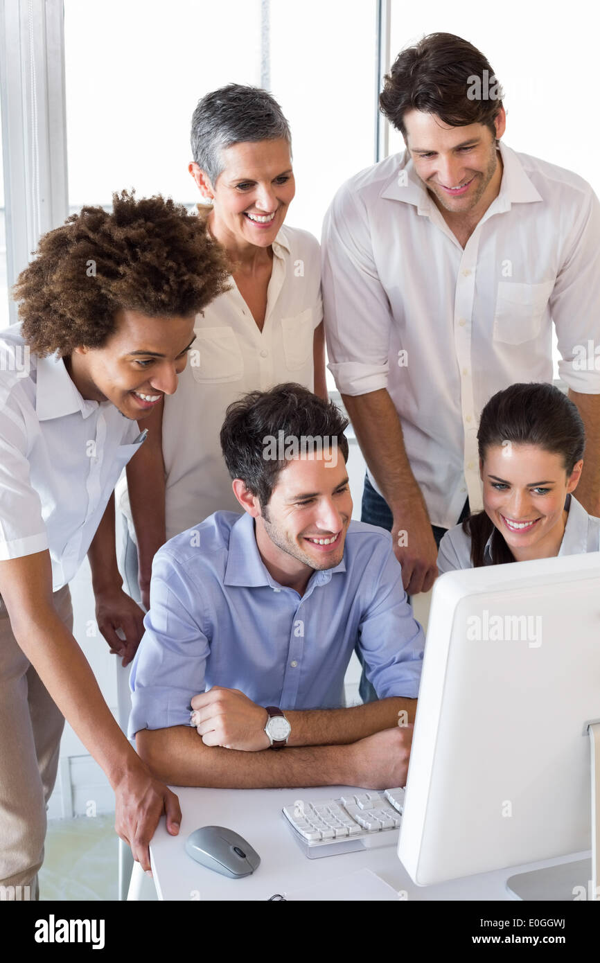 Attractive business people working hard on computer - Stock Image